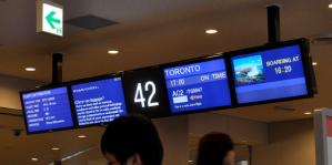 Airport flight information monitors for a gate 42