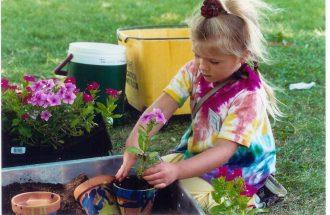 girl planting at kallah 2011